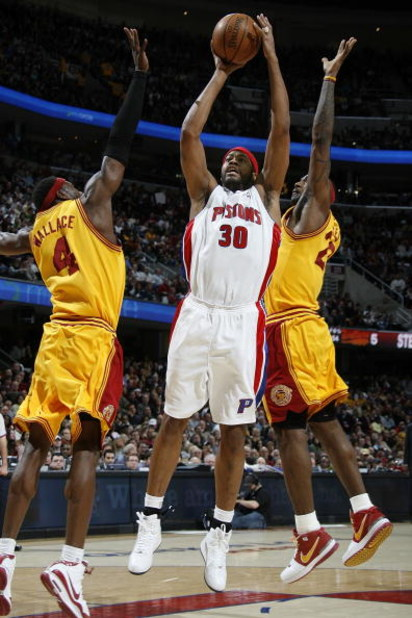 CLEVELAND - FEBRUARY 22:  Rasheed Wallace #30 of the Detroit Pistons gets a shot off between Ben Wallace #4 and LeBron James #23 of the Cleveland Cavaliers on February 22, 2009 at the Quicken Loans Arena in Cleveland, Ohio. Cleveland won the game 99-78. N
