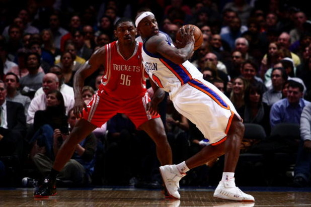 NEW YORK - JANUARY 26: Al Harrington #7 of the New York Knicks looks for options under pressure from Ron Artest #96 of the Houston Rockets at Madison Square Garden January 26, 2009 in New York City. NOTE TO USER: User expressly acknowledges and agrees tha