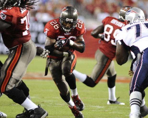 TAMPA, FL - AUGUST 17: Running back Warrick Dunn #28 of the Tampa Bay Buccaneers rushes upfield against the New England Patriots at Raymond James Stadium on August 17, 2008 in Tampa, Florida.   (Photo by Al Messerschmidt/Getty Images)