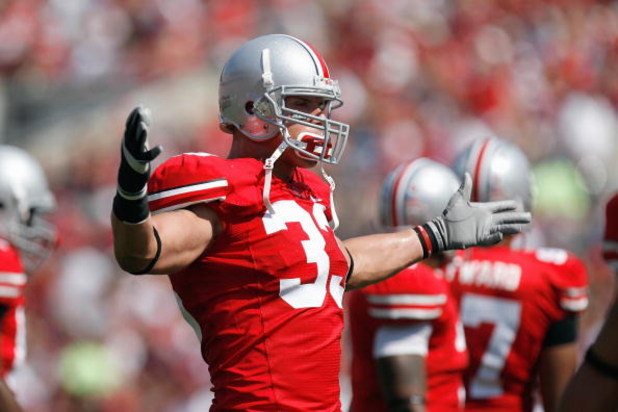 COLUMBUS, OH - SEPTEMBER 20:  James Laurinaitis #33 of the Ohio State Buckeyes celebrates on the field during the game against the Troy Trojans on September 20, 2008 at Ohio Stadium in Columbus, Ohio. Ohio State won the game 28-10. (Photo by Gregory Shamu