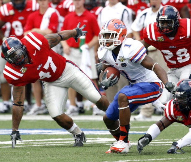 OXFORD, MS - SEPTEMBER 22:  Percy Harvin #1 of the Florida Gators runs against Tony Fein #47 of the Mississippi Rebels on September 22, 2007 at Vaught-Hemingway Stadium/Hollingsworth Field in Oxford, Mississippi. (Photo by Joe Murphy/Getty Images)