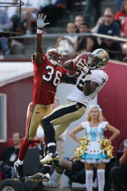 SAN FRANCISCO - OCTOBER 28:  Wide receiver Marques Colston #12 of the New Orleans Saints catches a 15-yard touchdown pass over defensive back Shawntae Spencer #36 of the San Francisco 49ers during a game at Monster Park October 28, 2007 in San Francisco,