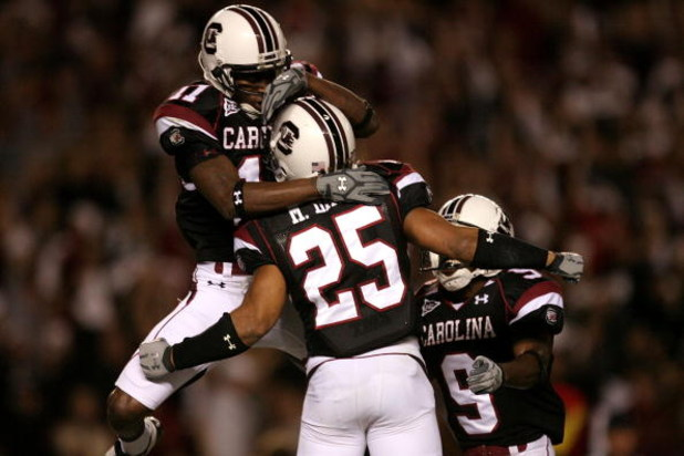 COLUMBIA, SC - NOVEMBER 01:  Teammates Moe Brown #9 and Kenny McKinley #11 celebrate with Mike Davis #25 after his touchdown against the Tennessee Volunteers # of the South Carolina Gamecocks during their game at Williams-Brice Stadium on November 1, 2008