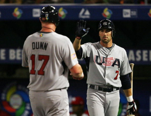 MIAMI - MARCH 14:  Adam Dunn #17 of the United States is congratulated by Mark DeRosa #7 after scoring against Puerto Rico during round 2 of the World Baseball Classic at Dolphin Stadium on March 14, 2009 in Miami, Florida. Puerto Rico defeated the United