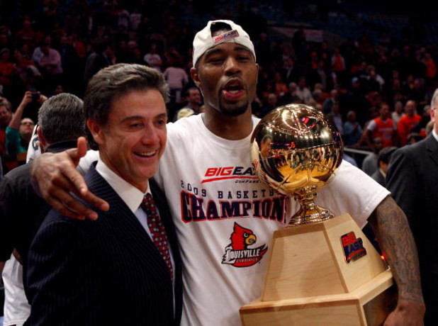 NEW YORK - MARCH 14: Head coach Rick Pitino and Terrence Williams #1 of the Louisville Cardinals celebrate with the trophy after defeating the Syracuse Orange to win the championship game of the Big East Tournament at Madison Square Garden on March 14, 20