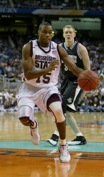 ATLANTA - MARCH 12:  Timmy Bowers #15 of the Mississippi State University Bulldogs drives to the basket against the Vanderbilt University Commodores during the second round of the SEC Men's Basketball Tournament at the Georgia Dome on March 12, 2004 in At
