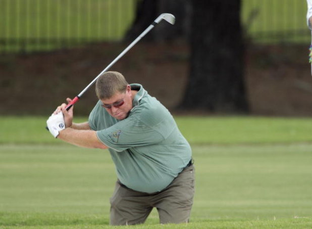 MADISON, MS - SEPTEMBER 19:  John Daly hits from the fairway bunker on the 11th hole during second round play in the Viking Classic at the Annandale Golf Club on September 19, 2008 in  Madison, Mississippi.  (Photo by Dave Martin/Getty Images)