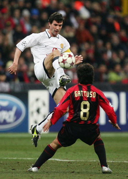 MILAN, ITALY - MARCH 8:  Roy Keane of Manchester United challenges Gattuso of AC Milan during the UEFA Champions League match between AC Milan and Manchester United on March 8, 2005 at the San Siro Stadium in Milan, Italy. (Photo by Mike Hewitt/Getty Imag