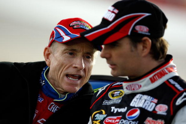 ATLANTA - MARCH 06:  Mark Martin, driver of the #5 Kellogg's Chevrolet talks with Jeff Gordon, driver of the #24 DuPont/National Guard Youth Challenge Chevrolet during qualifying for the NASCAR Sprint Cup Series Kobalt Tools 500 at the Atlanta Motor Speed