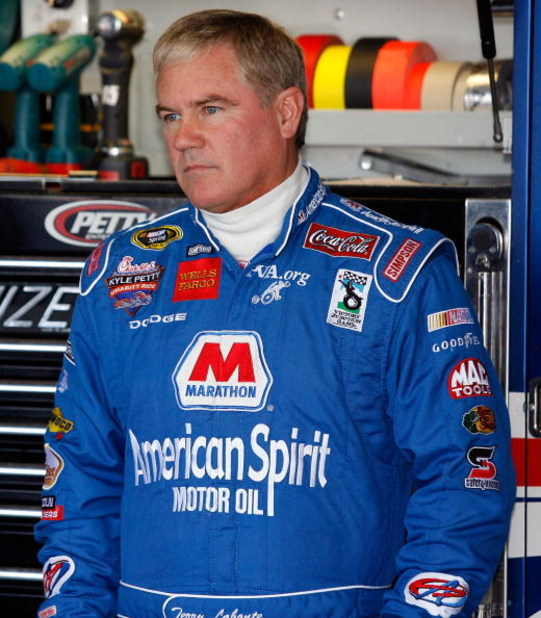 BROOKLYN, MI - AUGUST 15:  Terry Labonte, driver of the #45 Marathon American Spirit Motor Oil Dodge stands in the garage prior to practice for the NASCAR Sprint Cup Series 3M Performance 400 at Michigan International Speedway on August 15, 2008 in Brookl