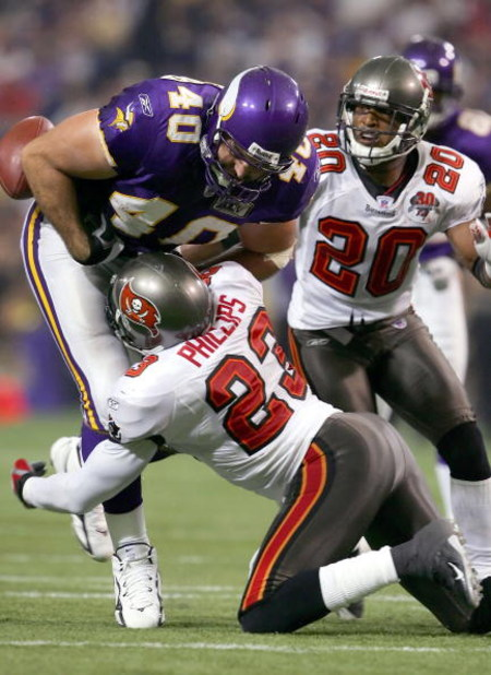MINNEAPOLIS, MN - SEPTEMBER 11:  Tight end Jim Kleinsasser #40 of the Minnesota Vikings fumbles the ball against safety Jermaine Phillips #23 of the Tampa Bay Buccaneers on September 11, 2005 at H.H.H. Metrodome in Minneapolis, Minnesota. The Bucs defeate