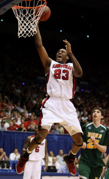DAYTON, OH - MARCH 22: Terrence Jennings #23 of the Louisville Cardinals drives to the hoop against the Siena Saints during the second round of the NCAA Division I Men's Basketball Tournament at the University of Dayton Arena on March 22, 2009 in Dayton,