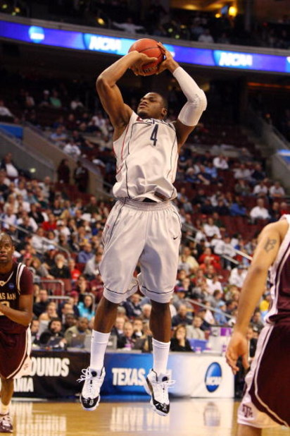 PHILADELPHIA - MARCH 21:  Jeff Adrien #4 of the Connecticut Huskies shoots against the Texas A&M Aggies during the second round of the NCAA Division I Men's Basketball Tournament at the Wachovia Center on March 21, 2009 in Philadelphia, Pennsylvania.  (Ph