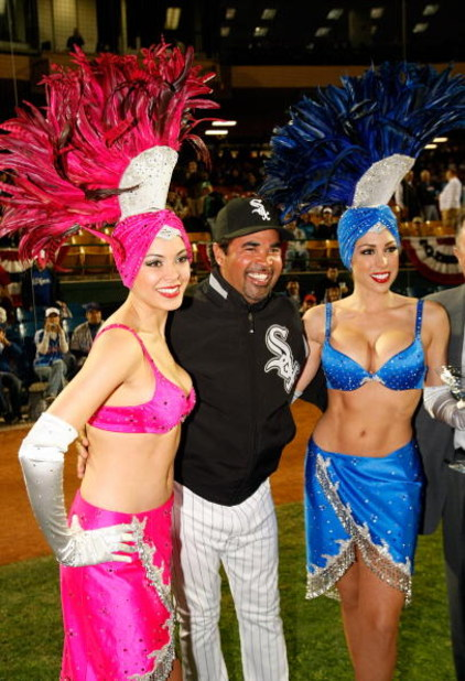 LAS VEGAS - MARCH 04:  (L-R) Chicago White Sox manager Ozzie Guillen (C) poses with showgirls Tala McDonnough (L) and Jennifer Gagliano (R) before an exhibition game between the White Sox and the Chicago Cubs at Cashman Field March 4, 2009 in Las Vegas, N