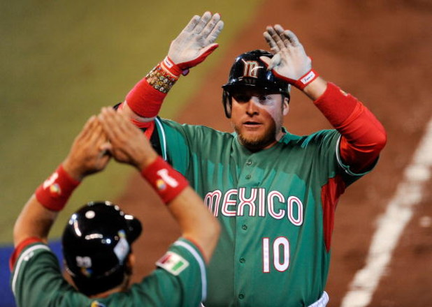 MEXICO CITY - MARCH 12:  Karim Garcia #10 of Mexico is congratulated after hitting a one-run home run against Cuba during the 2009 World Baseball Classic Pool B match on March 12, 2009 at the Estadio Foro Sol in Mexico City, Mexico.  Cuba won, 16-4. (Phot