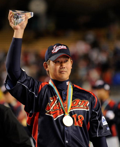 LOS ANGELES, CA - MARCH 23:  Daisuke Matsuzaka #18 of Japan holds up the the MVP trophy after defeating Korea during the finals of the 2009 World Baseball Classic on March 23, 2009 at Dodger Stadium in Los Angeles, California. Japan won 5-3 in 10 innings.