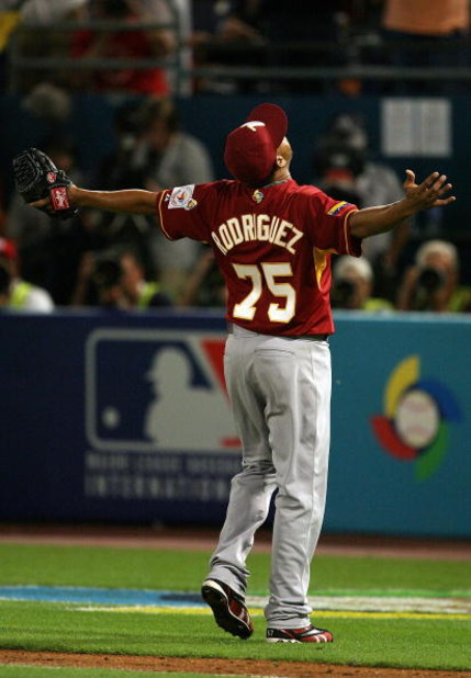 MIAMI - MARCH 16:  Closer Francisco Rodriguez #75 of Venezuela celebrates after finishing the eighth inning against Puerto Rico during day 3 of round 2 of the World Baseball Classic at Dolphin Stadium on March 16, 2009 in Miami, Florida. Venezuela defeate