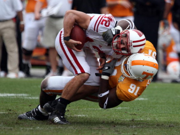 TAMPA, FL - JANUARY 01:  Tyler Donovan #12 of the Wisconsin Badgers is sacked by Robert Ayers #91 of  the Tennessee Volunteers during the Outback Bowl at Raymond James Stadium on January 1, 2008 in Tampa, Florida.  (Photo by Scott Halleran/Getty Images)