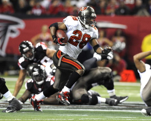 ATLANTA - DECEMBER 14: Running back Warrick Dunn #28 of the Tampa Bay Buccaneers rushes upfield against the Atlanta Falcons at the Georgia Dome on December 14, 2008 in Atlanta, Georgia.  (Photo by Al Messerschmidt/Getty Images)