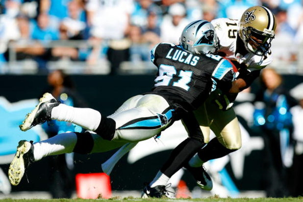 CHARLOTTE, NC - OCTOBER 19:  Ken Lucas #21 of the Carolina Panthers tackles Devery Henderson #19 of the New Orleans Saints during the game at Bank of America Stadium on October 19, 2008 in Charlotte, North Carolina.  (Photo by Kevin C. Cox/Getty Images)