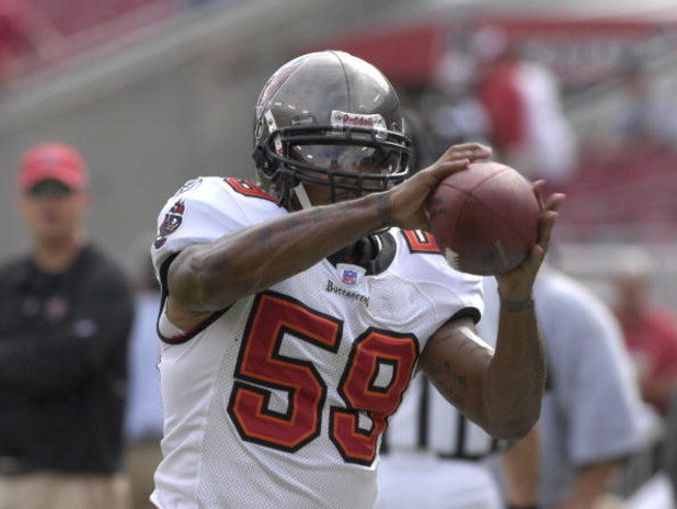 TAMPA, FL - OCTOBER 28:  Linebacker Cato June #59 of the Tampa Bay Buccaneers warms up for play against the Jacksonville Jaguars at Raymond James Stadium on October 28, 2007 in Tampa, Florida.  The Jaguars won 24 - 23. (Photo by Al Messerschmidt/Getty Ima