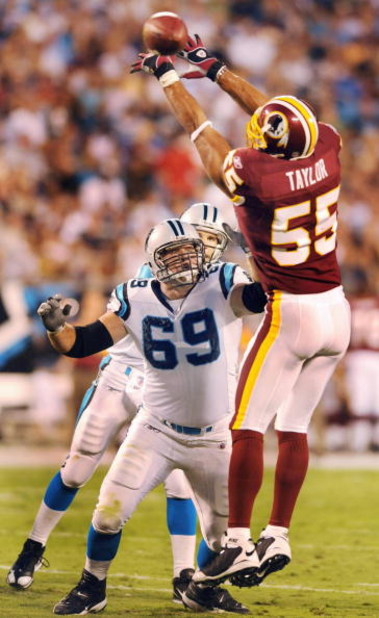 CHARLOTTE, NC - AUGUST 23   Offensive tackle Jordan Gross #69 of the Carolina Panthers tries to block defensive end Jason Taylor #55 of the Washington Redskins during the NFL preseason game at Bank of America Stadium on August, 23, 2008 in Charlotte, Nort