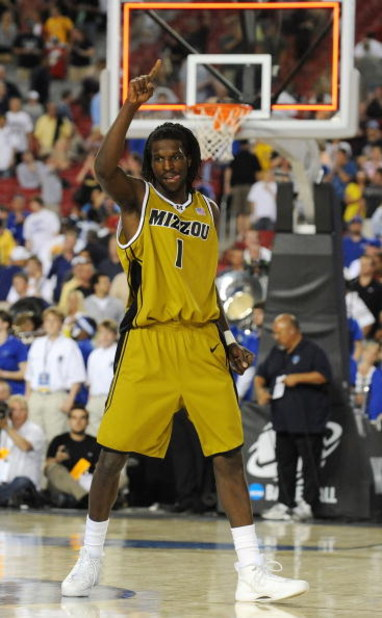 GLENDALE, AZ - MARCH 26:  Forward DeMarre Carroll #1 of the Missouri Tigers celebrates after defeating the Memphis Tigers 102-91 in the Sweet 16 of the NCAA Division I Men's Basketball Tournament at the University of Phoenix Stadium on March 26, 2009 in G