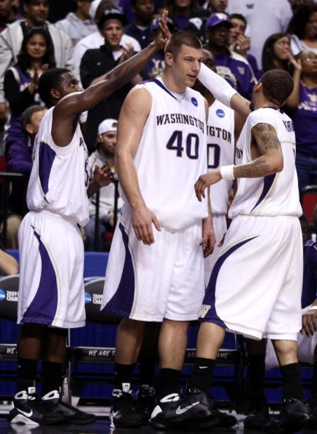 PORTLAND, OR - MARCH 19:  (L) Justin Dentmon #5 and (R) Venoy Overton #1 of the Washington Huskies give each other a five on the bench with teammate Jon Brockman #40 late in the second half against the Mississippi State Bulldogs during the first round of