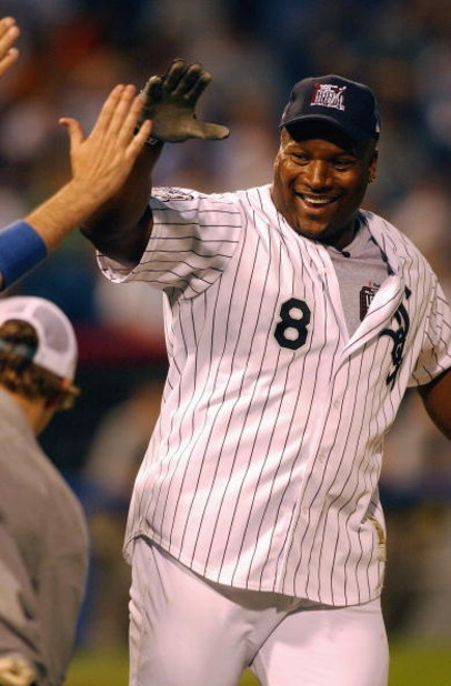 CHICAGO - JULY 13:  Former All-Star outfielder and NFL star Bo Jackson celebrates hitting a home run during the All Star Legends and Celebrity Softball Game on July 13, 2003 at U.S. Cellular Field in Chicago, Illinois. (Photo by Jonathan Daniel/Getty Imag