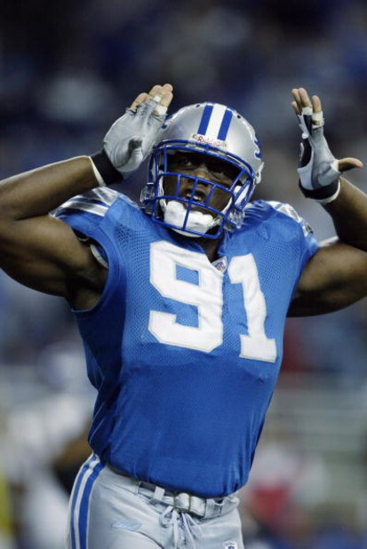 DETROIT- DECEMBER 29:  Defensive end Robert Porcher #91 of the Detroit Lions celebrates during the NFL game against the Minnesota Vikings at Ford Field on December 29, 2002 in Detroit, Michigan.  The Vikings defeated the Lions 38-36.  (Photo by Tom Pidgeo