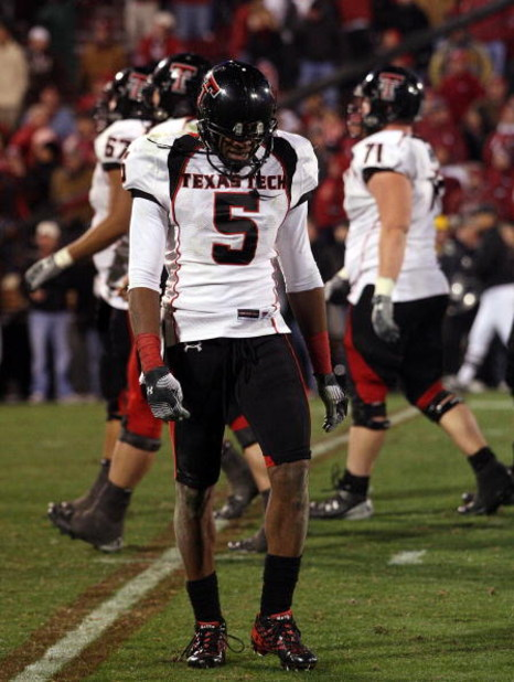 NORMAN, OK - NOVEMBER 22:  Wide receiver Michael Crabtree #5 of the Texas Tech Red Raiders walks off the field at the end of a 65-21 loss against the Oklahoma Sooners at Memorial Stadium on November 22, 2008 in Norman, Oklahoma.  (Photo by Ronald Martinez