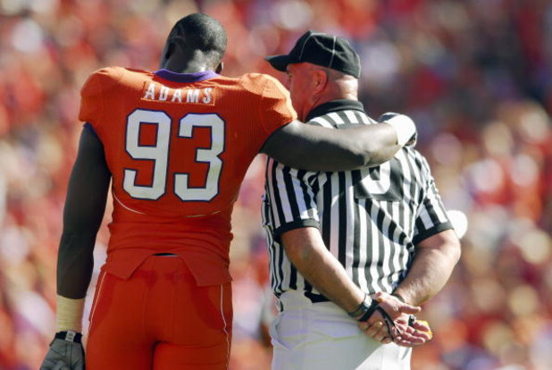 CLEMSON, SC - NOVEMBER 25:  Gaines Adams #93 of the Clemson Tigers talks with an official during the game against the South Carolina Gamecocks at Memorial Stadium on November 25, 2006 in Clemson, South Carolina. South Carolina won 31-28. (Photo by Grant H