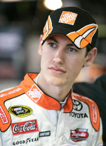 MARTINSVILLE, VA - MARCH 28: Joey Logano, driver of the #20 The Home Depot Toyota, in the gargage during practice for the NASCAR Sprint Cup Series Goody's Fast Pain Relief 500 at the Martinsville Speedway on March 28, 2009 in Martinsville, Virginia.  (Pho