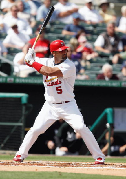JUPITER, FL - FEBRUARY 25:  Albert Pujols #5 of the St. Louis Cardinals bats against the Florida Marlins during a spring training game at Roger Dean Stadium on February 25, 2009 in Jupiter, Florida. The Marlins and the Mets played to a 5-5 tie in 10 innin