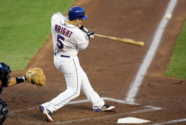 NEW YORK - AUGUST 22:  David Wright #5 of the New York Mets hits an RBI single in the first inning against the Houston Astros on August 22, 2008 at Shea Stadium in the Flushing neighborhood of the Queens borough of New York City.  (Photo by Jim McIsaac/Ge