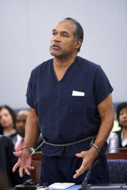 LAS VEGAS - DECEMBER 5:  OJ Simpson speaks in court prior to his sentencing at the Clark County Regional Justice Center December 5, 2008 in Las Vegas, Nevada.  Simpson and co-defendant Clarence 'C.J.' Stewart were sentenced on 12 charges, including felony