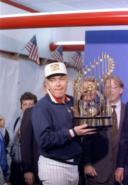 Manager Tom Kelly of the Minnesota Twins celebrates with the trophy after game seven of the World Series against the Atlanta Braves.