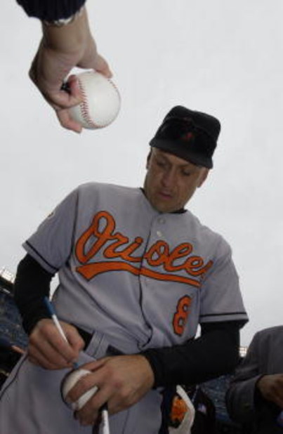 30 Sep 2001: Cal Ripken Jr. of the Baltimore Orioles signs autographs before his final game against the New York Yankees at Yankee Stadium in the Bronx, New York. DIGITAL IMAGE. Mandatory Credit: Ezra Shaw/Allsport