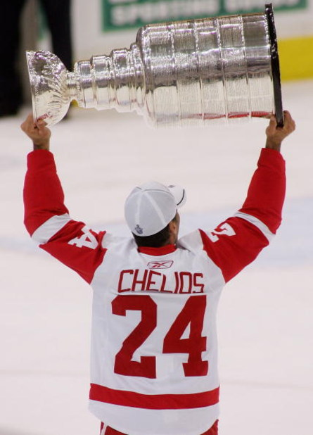 PITTSBURGH - JUNE 04:  Chris Chelios #24 of the Detroit Red Wings celebrates with the Stanley Cup after defeating the Pittsburgh Penguins in game six of the 2008 NHL Stanley Cup Finals at Mellon Arena on June 4, 2008 in Pittsburgh. Pennsylvania. The Red W