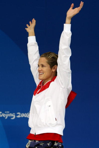 BEIJING - AUGUST 17:  Silver medalist Dara Torres of the United States celebrates on the podium before receiving her medal in the Women's 50m Freestyle final held at the National Aquatics Centre during Day 9 of the Beijing 2008 Olympic Games on August 17,