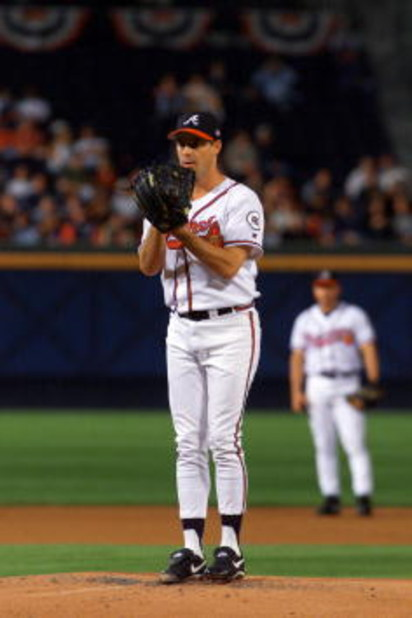20 Oct 2001:  Greg Maddux #31 of the Atlanta Braves prepares to deliver a pitch against the Arizona Diamondbacks in the first inning of game four of the National League Championship Series at Turner Field in Atlanta, Georgia. DIGITAL IMAGE: Mandatory Cred