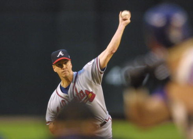 17 Oct 2001:  Pitcher Tom Glavine #47 of the Atlanta Braves throws a pitch during the first inning of Game 2 of the NLCS against the Arizona Diamondbacks at Bank One Ballpark in Phoenix, Arizona. DIGITAL IMAGE  Mandatory Credit: Jeff Gross/ALLSPORT