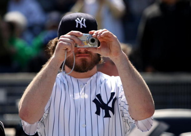 NEW YORK - APRIL 02:  A fan takes a picture during a New York Yankees workout at the new Yankee Stadium on April 2, 2009 in the Bronx borough of New York City.  (Photo by Ezra Shaw/Getty Images)