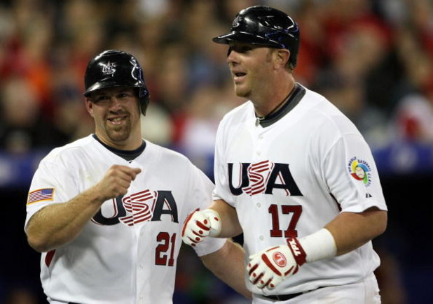 TORONTO, ON - MARCH 07:  Kevin Youkilis #21 of the USA congratulates teammate Adam Dunn #17 after Dunn hit a two run homer to drive home Youkilis against Canada during the 2009 World Baseball Classic Pool C match on March 7, 2009 at the Rogers Center in T