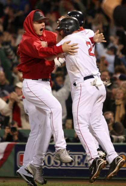 BOSTON - OCTOBER 16:  Relief pitcher Jonathan Papelbon #58 of the Boston Red Sox celebrates with Kevin Youkilis #20 after defeating the Tampa Bay Rays in game five of the American League Championship Series during the 2008 MLB playoffs at Fenway Park on O