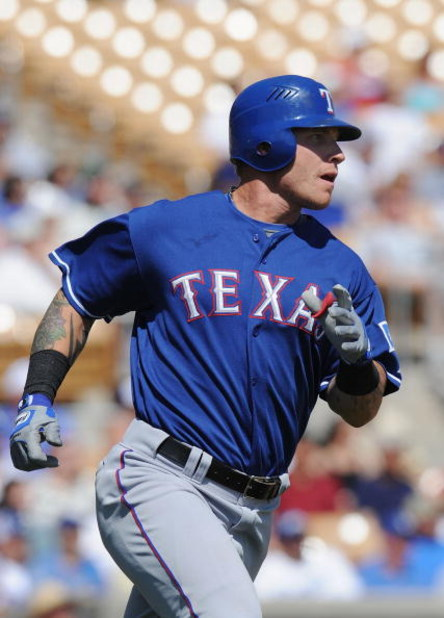 GLENDALE, AZ - MARCH 13:   Josh Hamilton #32 of the Texas Rangers runs the bases after hitting a homerun in the first inning during a Spring Training game against the Los Angeles Dodgers on March 13, 2009 at Camelback Ranch in Glendale, Arizona.  (Photo b