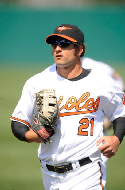 FORT LAUDERDALE, FL - MARCH 2: Nick Markakis #21 of the Baltimore Orioles runs in from the outfield against the Boston Red Sox during a spring training game at Fort Lauderdale Stadium on March 2, 2009 in Fort Lauderdale, Florida. (Photo by Rob Tringali/Ge
