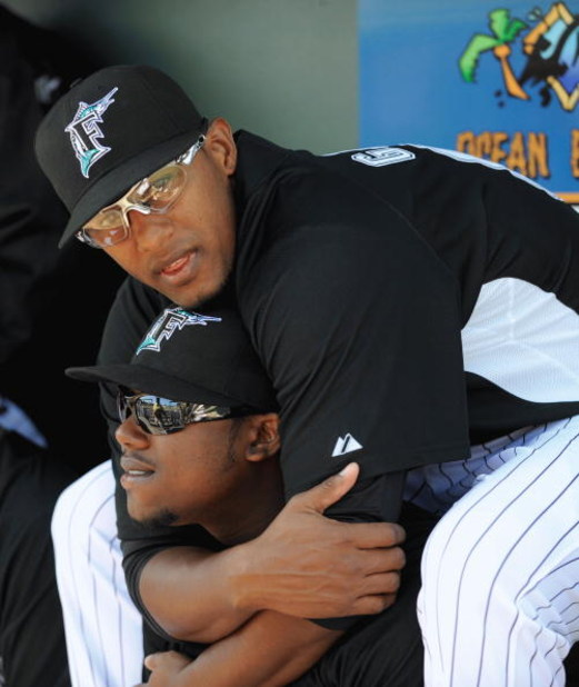 JUPITER, FL - FEBRUARY 27: Hanley Ramirez #2 of the Florida Marlins gets a hug from Andy Gonzalez #50 before a game against the Baltimore Orioles during a spring training game at Roger Dean Stadium on February 27, 2009 in Jupiter, Florida. (Photo by Rob T