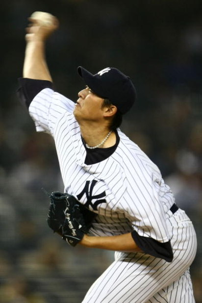 NEW YORK - APRIL 03:  Chien-Ming Wang #40 of the New York Yankees pitches against the Chicago Cubs during their game on April 3, 2009 at Yankee Stadium in the Bronx borough of New York City. The exhibition game is the first game to be played at the new Ya