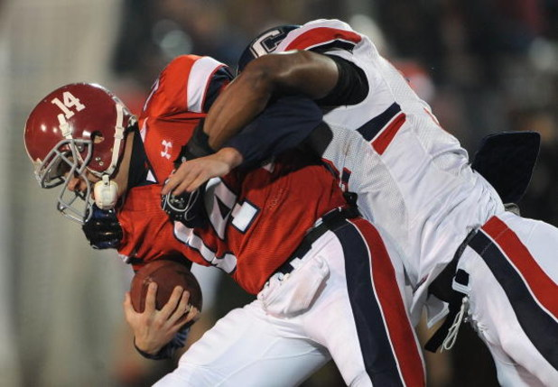 MOBILE, AL - JANUARY 24:  Quarterback John Parker Wilson #14 of the North team is sacked by Cody Brown #52 of the South team during the Under Armour Senior Bowl on January 24, 2009 at Ladd-Peebles Stadium in Mobile, Alabama.  (Photo by Ronald Martinez/Get
